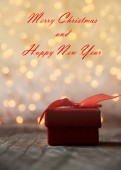 Red gift box with bokeh background — Stock Photo