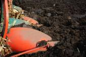 Plough on a tractor working in the field — Stock Photo