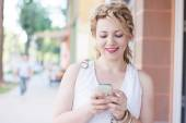 Curly blond girl on the phone — Stock Photo