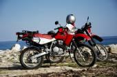 Honda motorbikes on the beach — Stock Photo