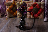 Hookah on a background of oriental cushions — Stock Photo