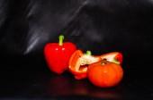 Fresh sweet pepper, tomato. On a black background. — Stock Photo