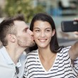 Happy couple taking a selfie photo with a smart phone in a restaurant terrace — Stock Photo #78550408
