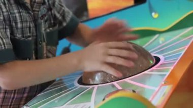 A young boy playing game machine — ストックビデオ