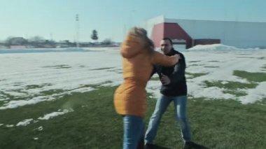 Handsome man spinning around his girlfriend — Stock Video