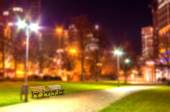 Night street at city. Blurred photo. Background — Stock Photo