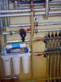 Close up of heating water system with pipes, valves and pump — Stock Photo