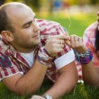 Man and woman on the grass — Stock Photo #70362649