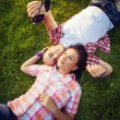 Man and woman on the grass — Stock Photo #70362759
