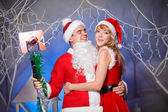 Sexy Santa and elf girl — Stock Photo