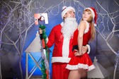 Santa Claus and Snow Maiden sexy — Stock Photo