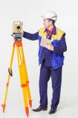 Worker looking into the level — Stock Photo