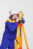 Worker and theodolite — Stock Photo