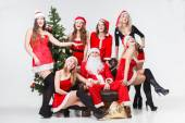 Santa and sexy Santa's girls — Stock fotografie