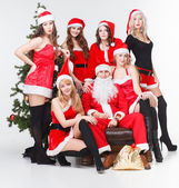 Santa and sexy Santa's girls — Fotografia Stock