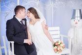 The groom, the bride winter studio — Stock Photo