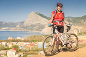 Woman cycling tourist — Stock Photo