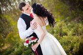Groom hugs bride — Stock Photo