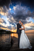 Groom, bride, sunset, clouds — Stock Photo