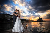 Groom, bride, sunset, beach — Stock Photo