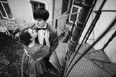 Young beautiful couple near old house at the stairs — Fotografia Stock