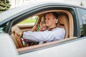 Wedding beautiful couple in traditional dress in exotic supercar — Stock Photo