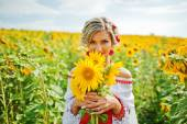 beautiful bride in traditional dress at the sunflower — Stock Photo
