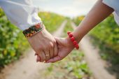 Pair of hands on background trails — Stock Photo