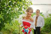 Wedding beautiful couple in traditional dress on the dock — Stock Photo