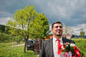 Groom on the background of the cloudy sky — Stock Photo