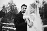 Wedding couple under the rain — Stock Photo