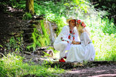 Young lower beautiful couple in traditional dress kissing — Stock Photo