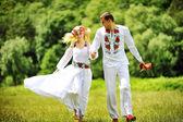 Young  beautiful couple in traditional dress having fun — Stock Photo