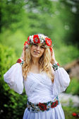 Young  beautiful blonde girl in traditional dress — Stock Photo