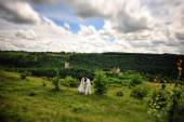 Young  beautiful couple in traditional dress at the picturesque — Stock Photo