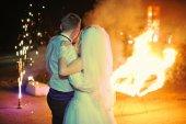 Wedding couple on fire show — Stock Photo
