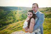 Wedding couple on the rock — Stock Photo