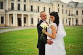 Wedding  adult couple in the courtyard of castle  — Stock Photo