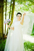 Gorgeus brunette bride outdoors — Stock Photo