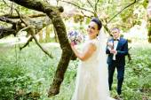 Gorgeus wedding couple on green sunny forest — Stock Photo
