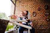 Wedding couple at vintage cafe at autumn day — Stock Photo