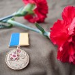 Постер, плакат: Medal 70 Years of Liberation of Ukraine from the Nazis and two red carnations