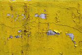 Cracked paint wall texture yellow — Stock Photo
