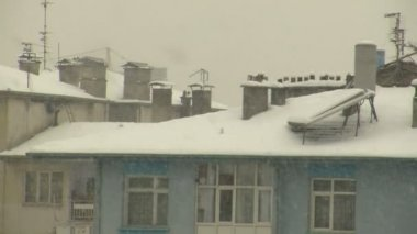 Snow covered roofs — ストックビデオ