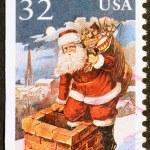 Santa Claus entering a chimney, stamp — Stock Photo #71204333