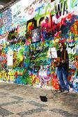 Musician at John Lennon Wall — Stock Photo