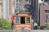 Cable car climbing hill — Stock Photo