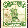 Chinese junk on old postage stamp — Stock Photo #74591863
