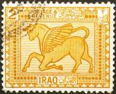 Assyrian winged bull on iraqi stamp — Stock Photo