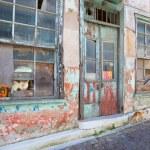 Greek abandoned store — Stock Photo #77261180
